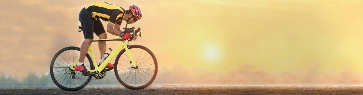 Cyclist riding into sunset with the help of fabuleaf™ Full Spectrum Premium Hemp Flower CBD Products